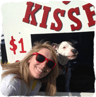 Woman and dog at a kissing booth